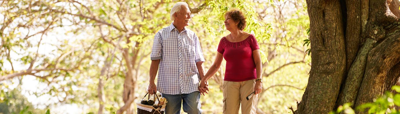 Senoir Couple Walking in Nature - StoneBrook Townhomes and Cottages